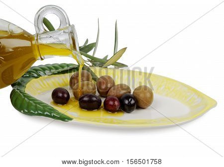 olive oil and olives on plate, studio shot