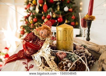 On Festive Table Cones, Candles And Doll.