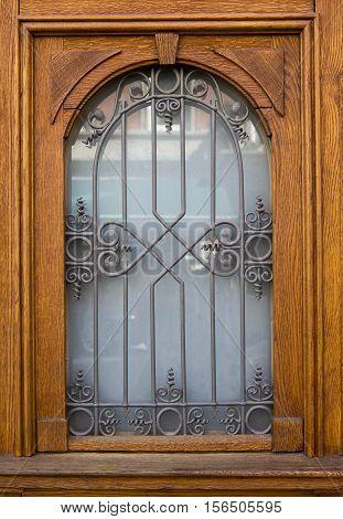 beautiful wooden rustic door with ironwork and window