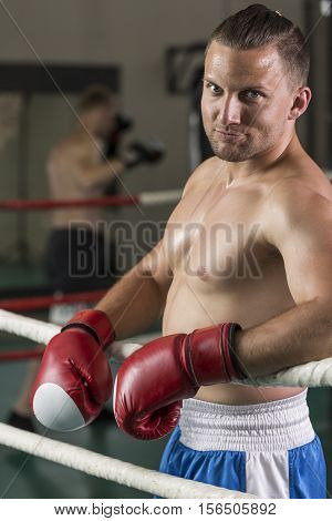 Smiling Boxer Standing On Ring