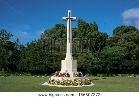 Labuan Malaysia-Nov 14,2016:White cross in the Commonwealth World War II graveyard in Labuan,Malaysia.Remembrance Day or Poppy Day in Borneo will be observed at Labuan World War II Memorial ground.