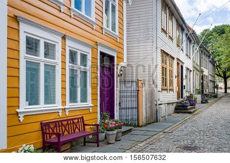 Wooden houses at old street of Bergen, popular touristic town in Norway.