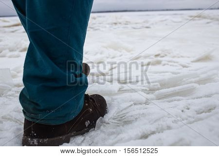 A Man Comes On The Weak Bad River Ice Concept danger falling through the ice.