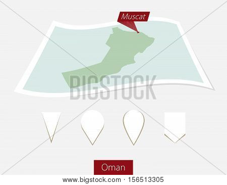 Curved Paper Map Of Oman With Capital Muscat On Gray Background. Four Different Map Pin Set.