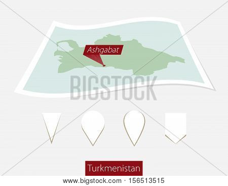 Curved Paper Map Of Turkmenistan With Capital Ashgabat On Gray Background. Four Different Map Pin Se