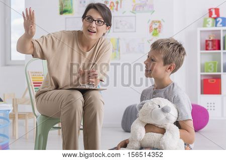 Boy During Visit At A Psychotherapist