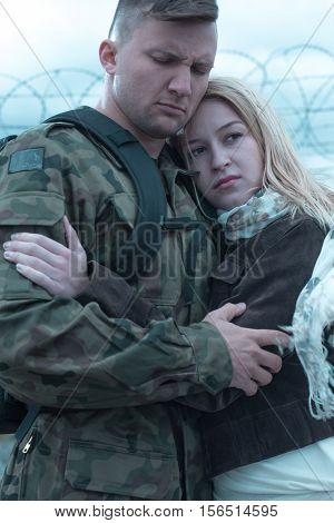 Sad Soldier Embracing His Worried Wife