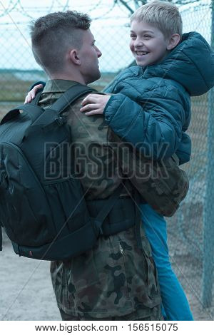 Soldier Holding His Happy Son