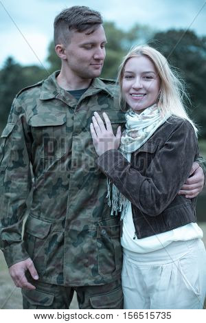 Soldier Embracing His Smiling Wife