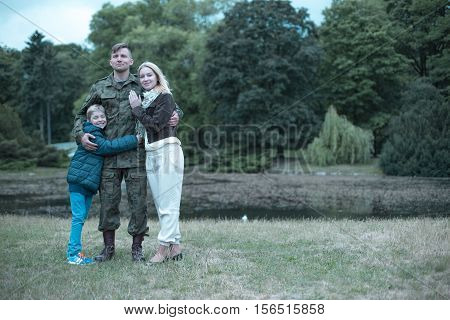 Soldier Spending Time With His Wife And Son