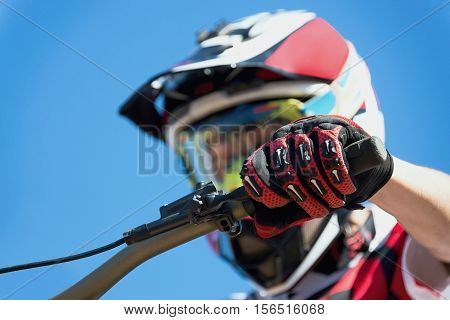 Rider mountain bike downhill detail hand when braking