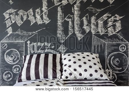 Bed Standing Against A Chalkboard Wall