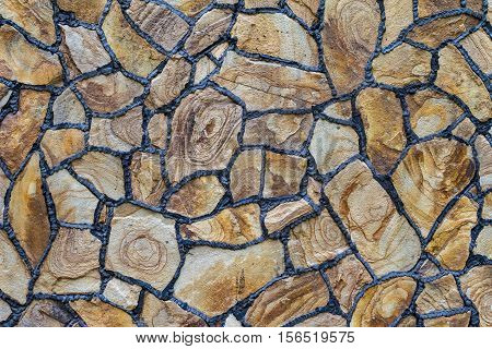 Natural stone for construction. Texture facing surface of natural stone with black seams.