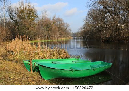 two boats on river moorage in park