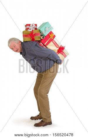Smiling senior man holding too many Christmas presents