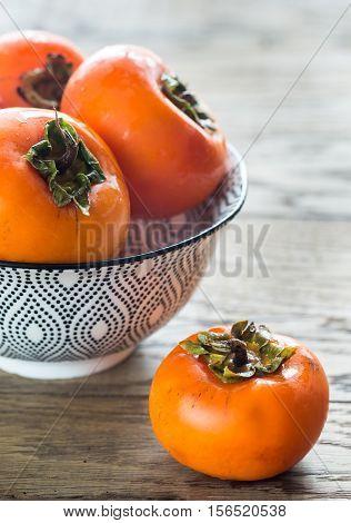 Bowl Of Fresh Persimmons