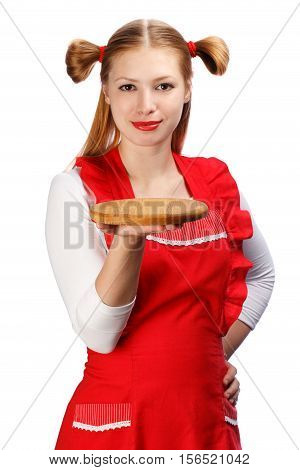 Young beautiful attractive smiling housewife in bright red apron with funny ponytails holding wooden cutting board isolated on white background.