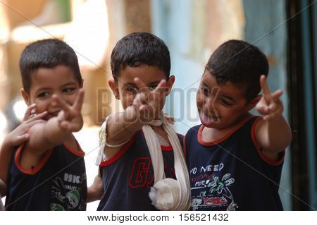 BEIRUT, LEBANON-AUGUST 2:Unidentified Palestinian children make victory sign in Shatila refugee camp on August 2, 2006 in Beirut,Lebanon.