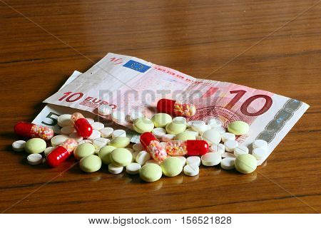 euro paper money and medical pills as part of paid treatment