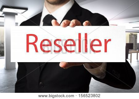 businessman in office Holding large sign reseller