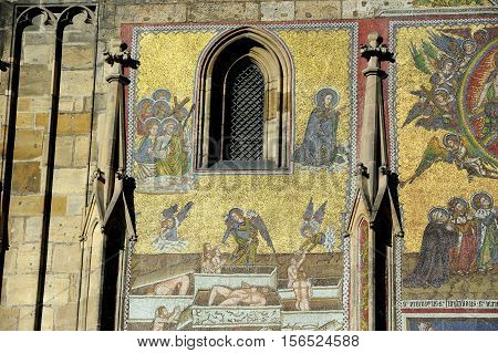 PRAGUE - January 30, 2014 - Mosaic of Resurrection and Last Judgment of Christ on  on St Vitus cathedral, Prague Castle, Czech Republic