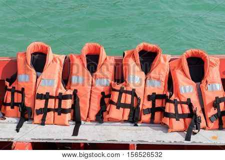 close up of Life jacket on boat with sea background . equipment for safety in water transportation.