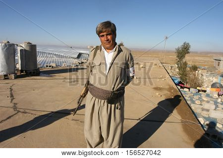 ARBIL,IRAQ-JANUARY 23:Unidentified kurdish soldier stands guard on January 23,2007 in Arbil, Kurdistan, Iraq. They are called peshmerga in Iraq.