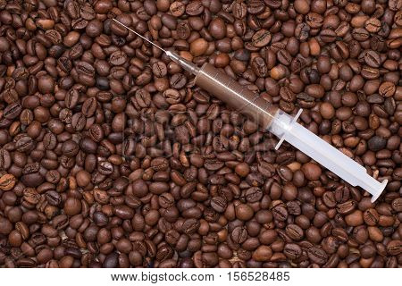 Your daily shot of coffee with a syringe on coffeebeans