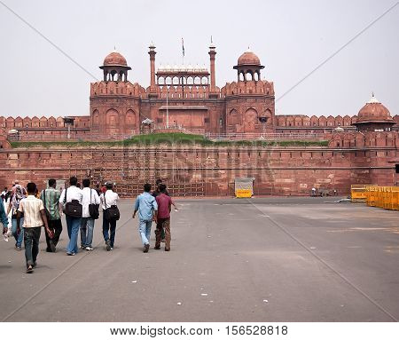 Delhi India - July 21 2011: Main entrance with Indian people at the Red Fort. Red Fort is a 17th century fort complex was designated a UNESCO World Heritage Site in 2007. It covers area of about 121.34 acres.