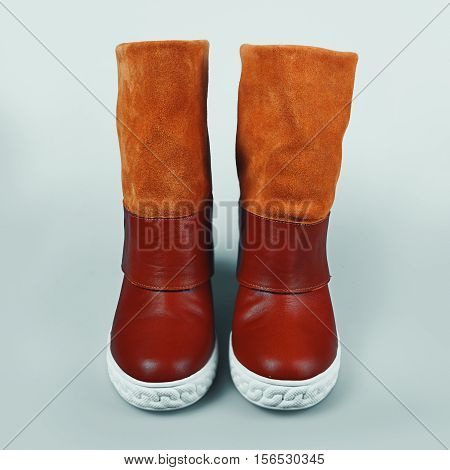 winter brown female boots in grey background