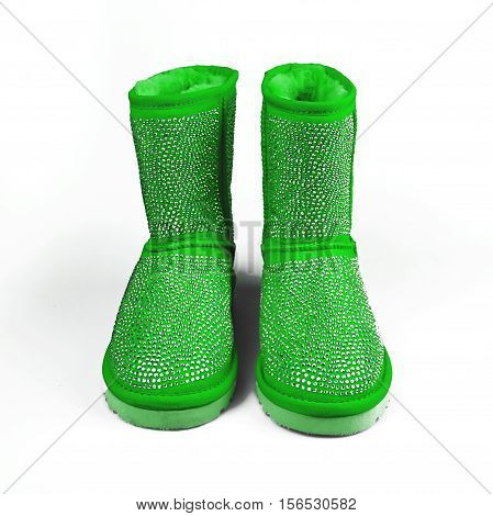 stylish winter green shoes over white background