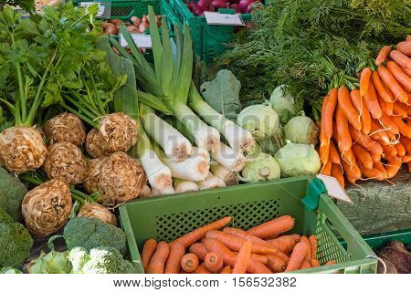 Fresh vegetables in boxes for sale at a market