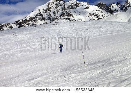 Skier On Ski Slope At Sun Winter Day