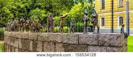 OULU FINLAND - JULY 06 2016: Sanna Koivisto's bronze sculpture Passage of Time depicts people from different centuries who have contributed to the success of the city. Maria Silfvan's Park Oulu.