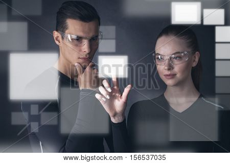 Virtual display concept man and woman select empty rectangular space