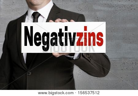 Negativzins (in German Negative Interest) Sign Is Held By Businessman
