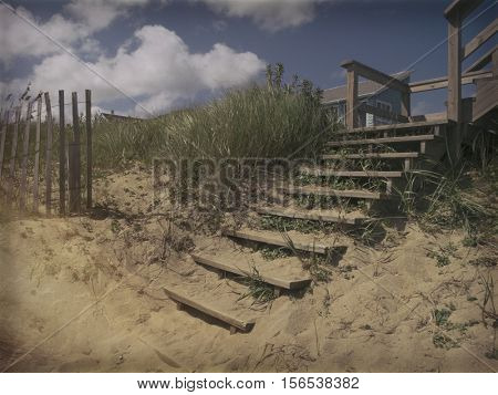 Vintage camera effect - Sand dunes and wooden stairs for beach access, Outer Banks North Carolina OBX