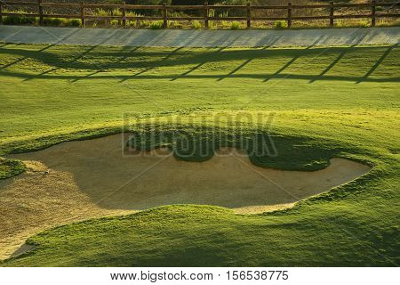 Sand bunker on the green golf course