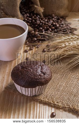 breaksfast and cup of coffee with coffee beans background.