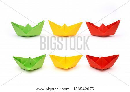 Colored paper boats origami. Green yellow and red paper