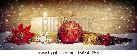 Christmas background with advent candle anad snow. Christmas decoration.Advent candle and decoration.