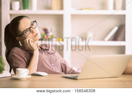 Businesslady Talking On Phone At Workplace