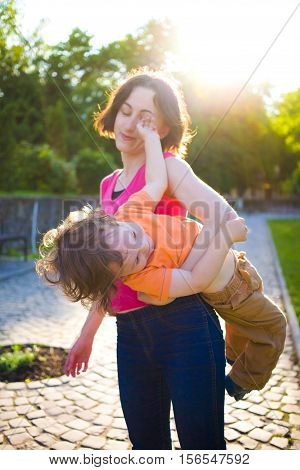 Mother And Her Child Played On The Street