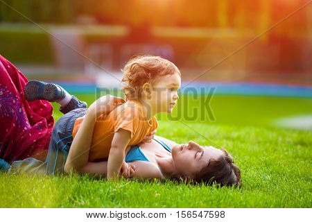 Mother With Child In The Park.