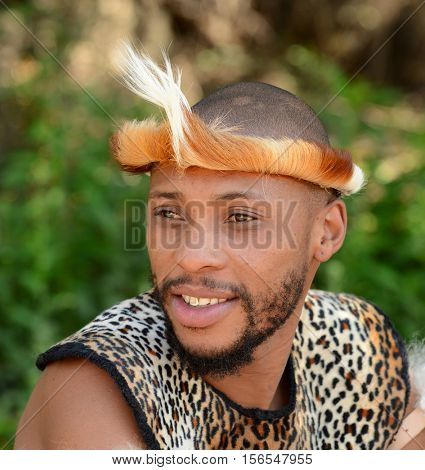 Gauteng, Lesedi Cultural Village. South Africa - 12 March, 2016. Zulu Warrior portrait. Zulu is one of the main tribes in South Africa. The Zulu were known for fierce fighting skills.