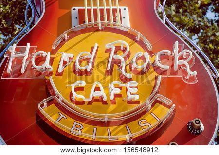 TBILISI, GEORGIA - OCT 10, 2016: Famous Hard Rock Cafe neon sign on facade of the popular bar on October 10, 2016. Chain of theme restaurants founded in 1971 now it works in 59 countries.