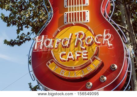 TBILISIб GEORGIA - OCT 10, 2016: Guitar at entrance of Hard Rock Cafe the popular rock'n'roll bar on October 10, 2016. Chain of theme restaurants founded in 1971 now it works in 59 countries.