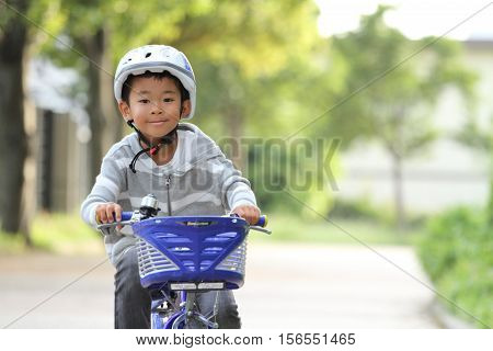 Japanese boy riding on the bicycle (first grade at elementary school)