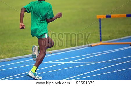 African Athlete During The Hurdling  Race