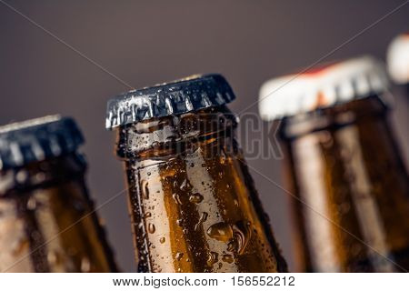 Close-up Of Fresh Cold Beer Ale Bottles With Drops And Stopper